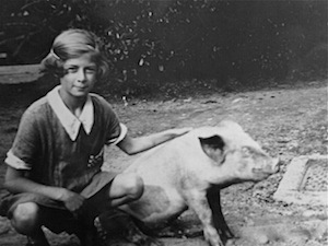 Mum with her pet pig circa 1930. Her pig would come into the house to sit beside her when she took piano lessons